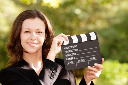 Woman with Smile and Closed Clapboard
